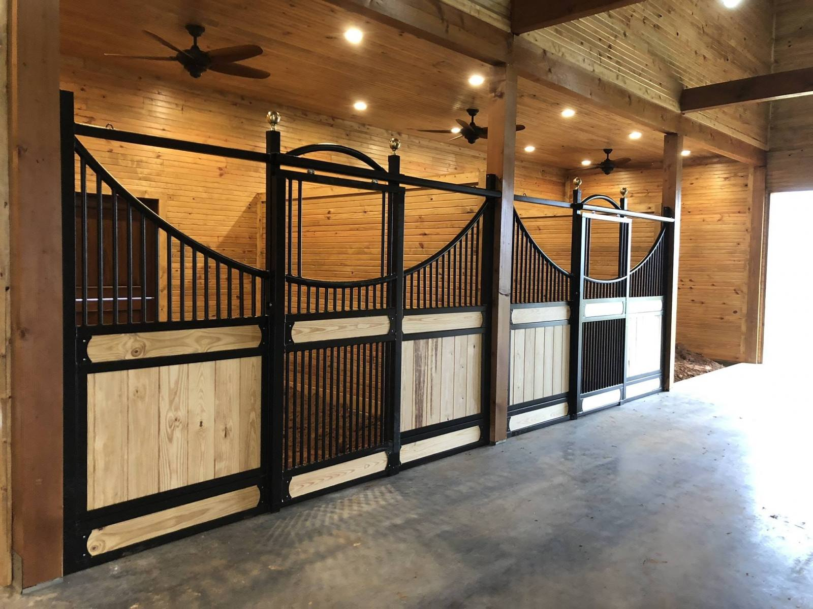 Stall Front No. 3A - European style full-grill sliding-door stall front with continuous arch, JR Elite wood load, and brass finials