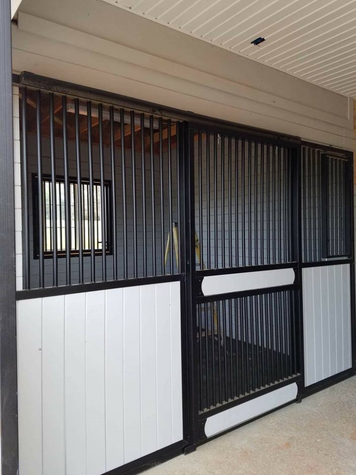 Stall Front No. 3L - Traditional sliding door front with vertical wood load, full grill door option, and hinged feed door