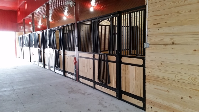 Stall Front No. 3S - Sliding door with JR Elite wood load, arched yoke drop, and hinged feed door