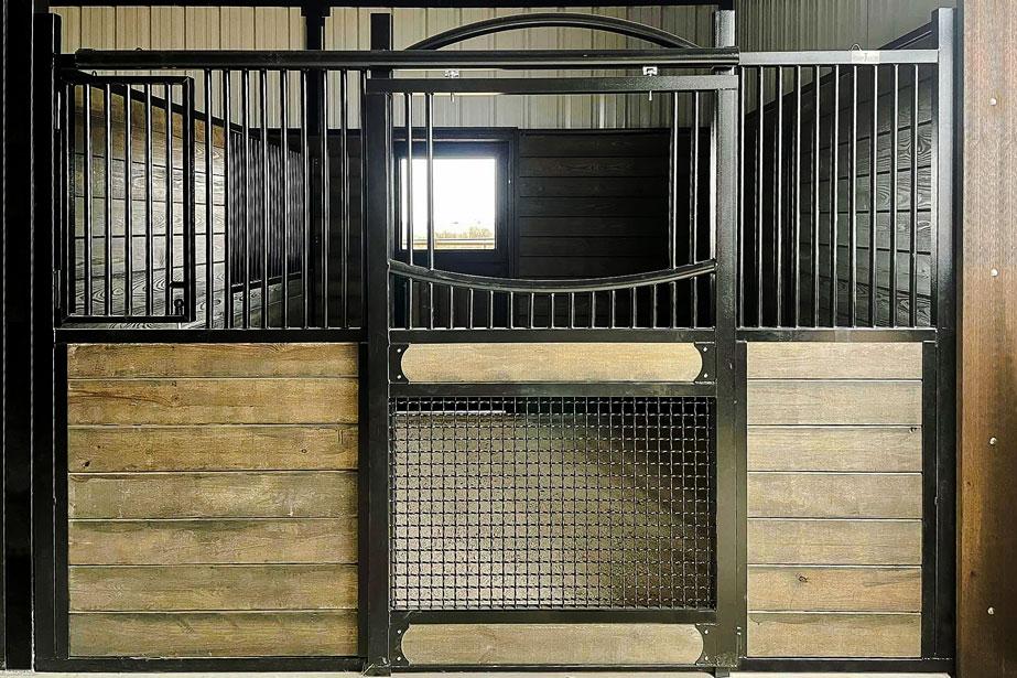 A mesh bottom horse stall door shut